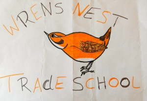 "Trade School Wrens Nest logo - drawing of a Wren and the words ""Wrens Nest Trade School"""